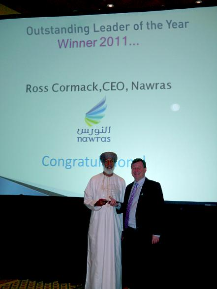 Abdulla Al Rawahy congratulates Ross Cormack on winning Outstanding Leader of the Year