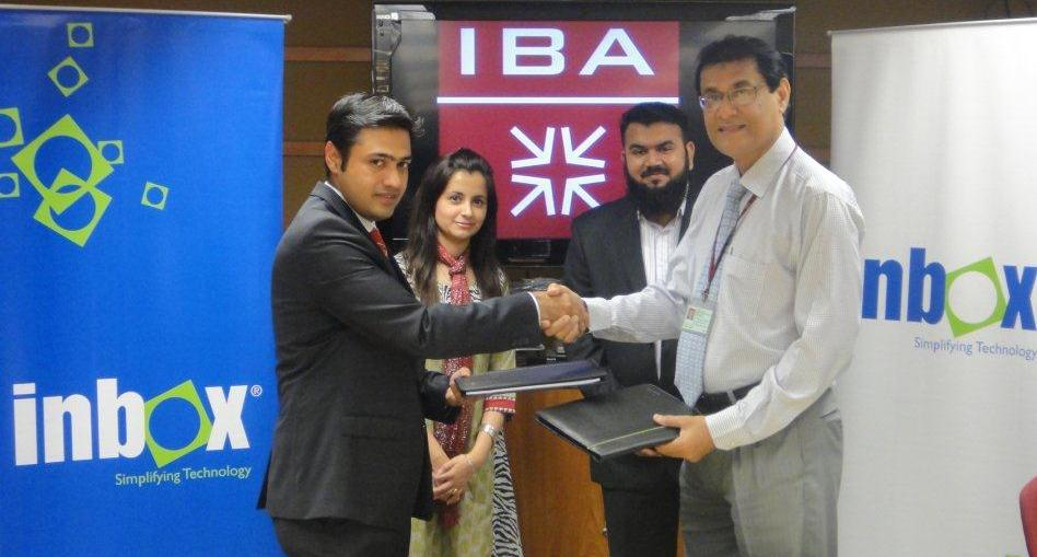 Mr. Shahzad Akbani (left) with Dr. Arshad Siddique (Right) at the Signing Ceremony held at IBA Main Campus