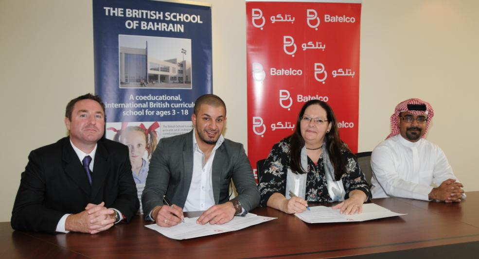 British School of Bahrain Head Karen Moffat and Batelco Youth Segment Marketing Manager Mohamed Abdulaal sign the agreement in the presence of British School representative Stephen Spicer and Batelco Sales Manager Mohamed Al Khalifa