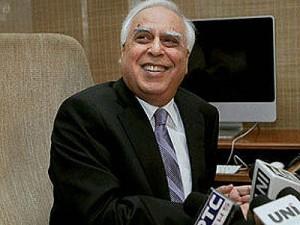 Kapil Sibal questions telecom secretary on crossholding rules
